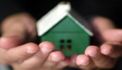 photo of house in hands