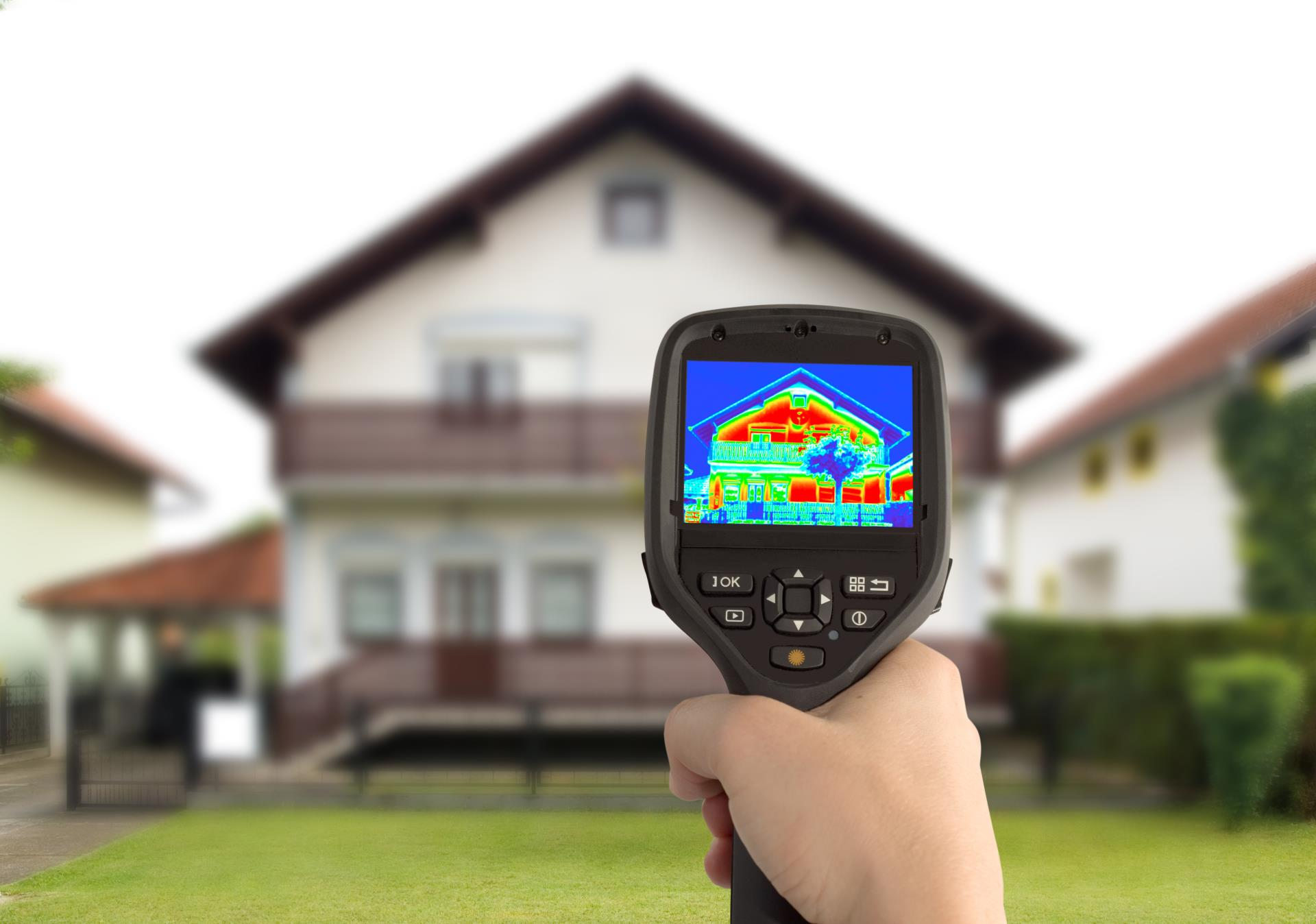Person conducting heat assessment of house