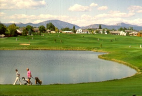 Golfers Walking by the Lake