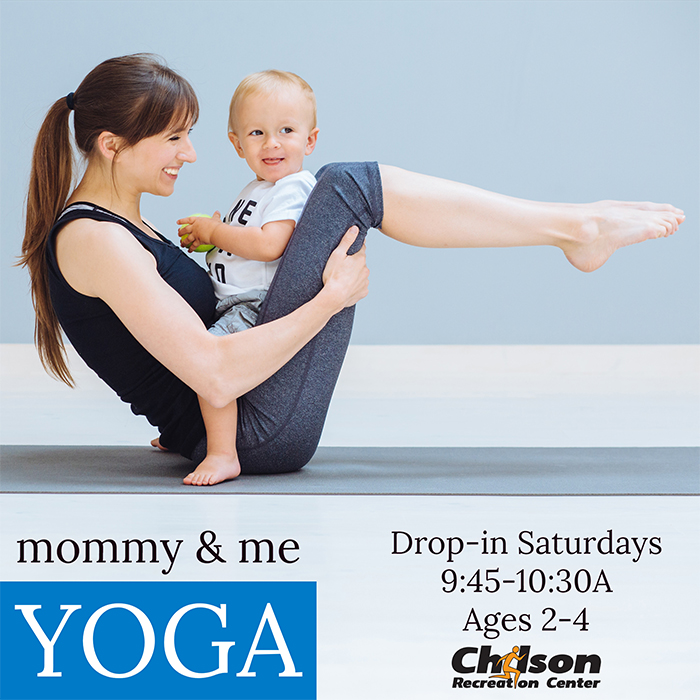 mother in yoga pose with child on her lap