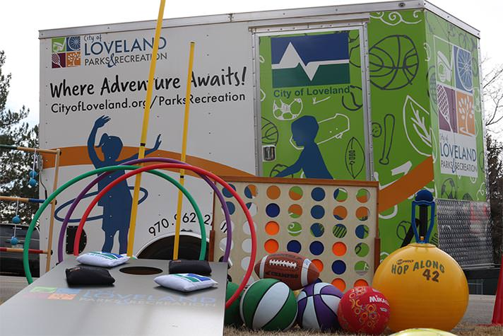 outdoor games displayed in front of mobile recreation trailer