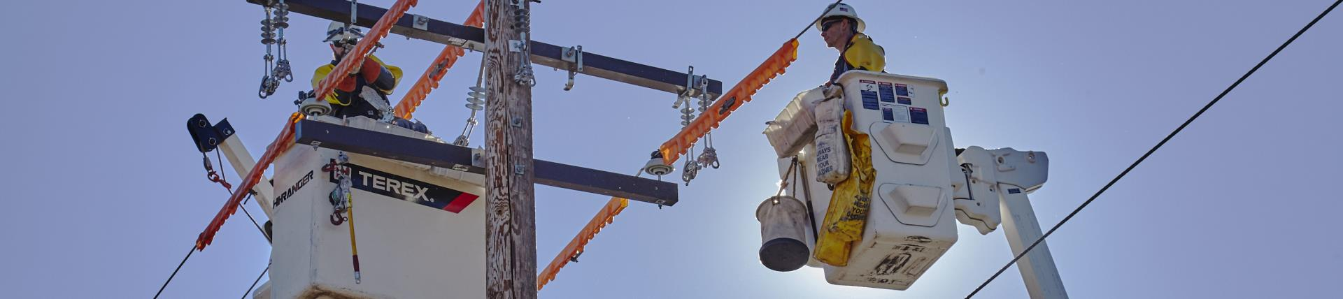 Men in Bucket truck working on power lines