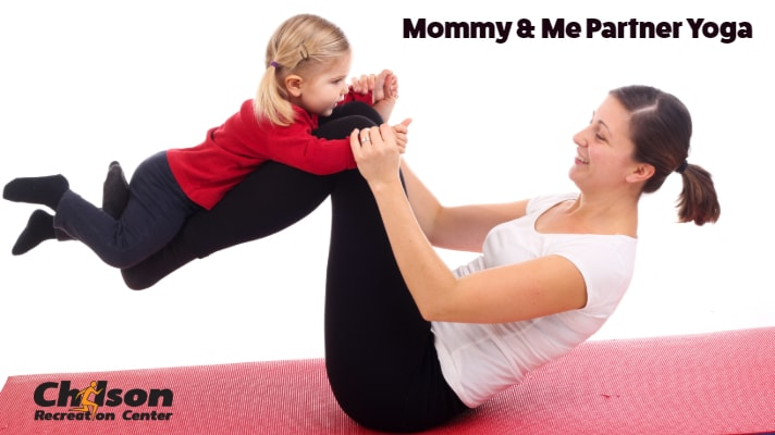 mother and child doing yoga