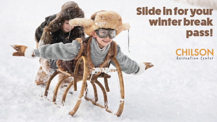 two boys in snow on old-fashioned sled