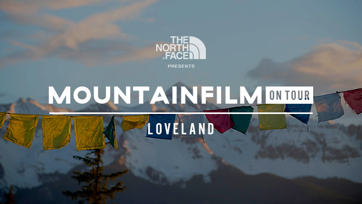 prayer flags with mountain backdrop representing Mountainfilm on Tour - Loveland