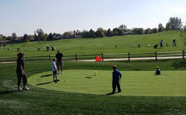 family on putting green at Mini-Course
