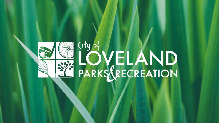 grass with Loveland Parks & Recreation logo